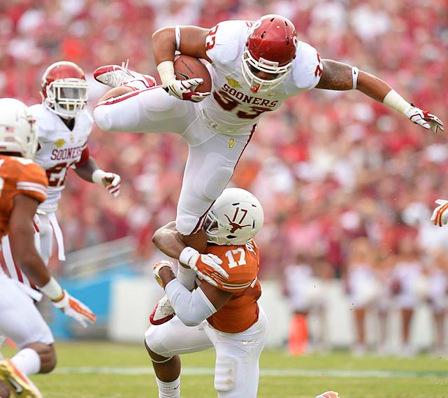 Texas safety Adrian Phillips drags down Oklahoma fullback Trey Millard. The Longhorns scored an upset in this year's Red River Rivalry, beating the Sooners 36-20.