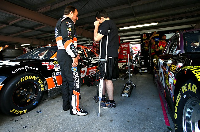 Tony Stewart (right) hopes to be back behind the wheel in time for the Daytona 500.