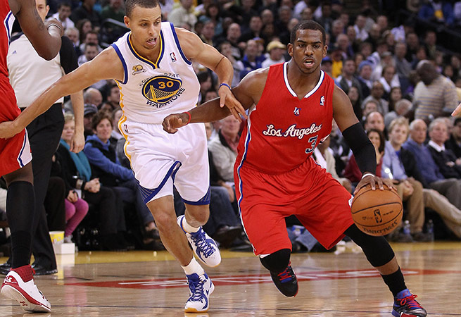 With the Lakers fading, Stephen Curry (left) and Chris Paul become the new faces of the Pacific Division.