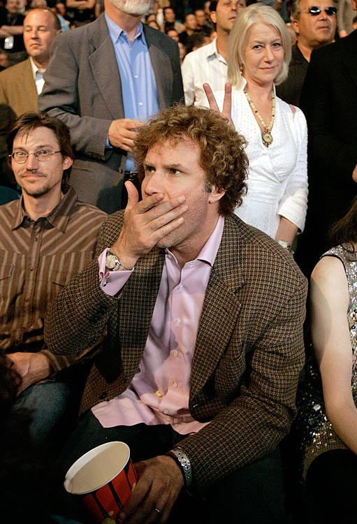 Helen Mirren puts up rabbit ears behind Will Ferrell as they attend the Oscar De La Hoya vs. Floyd Mayweather Jr. fight on May 5, 2007 at the MGM Grand Garden Arena in Las Vegas.
