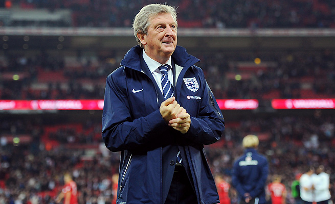 Manager Roy Hodgson guided England to a World Cup berth Tuesday with a 2-0 victory over Poland.