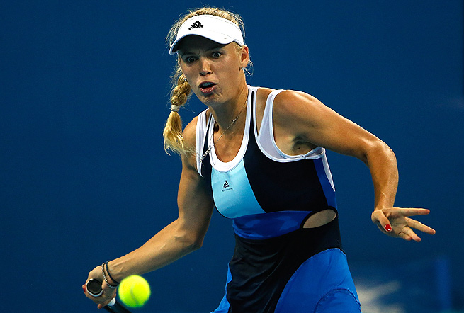 Caroline Wozniacki cruised past Monica Niculesco 6-3, 6-2 to reach the quarterfinals.