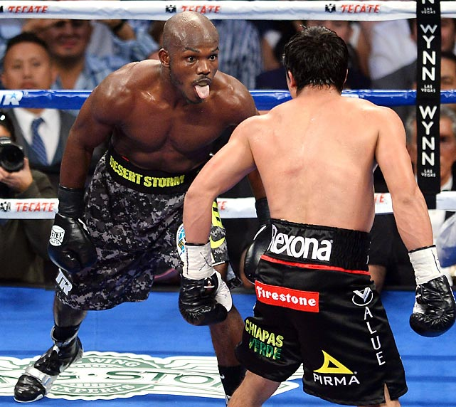 Welterweight champ Timothy Bradley Jr. demonstrates his mastery of the stick and move as the fifth round of his bout with Juan Manuel Marquez winds down in Las Vegas. Bradley won in a spit, er, split decision.