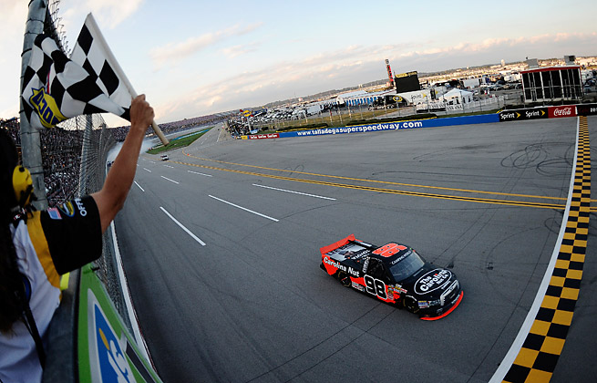 Johnny Sauter emerged as the only truck to emerge from a 12-vehicle crash late to win at Talladega.