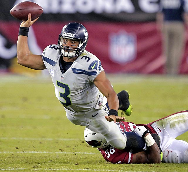 Seattle Seahawks quarterback Russell Wilson gets a pass off just before Arizona Cardinals linebacker Karlos Dansby brings him down. Wilson's Seahawks moved to 6-1 with a 34-22 win.