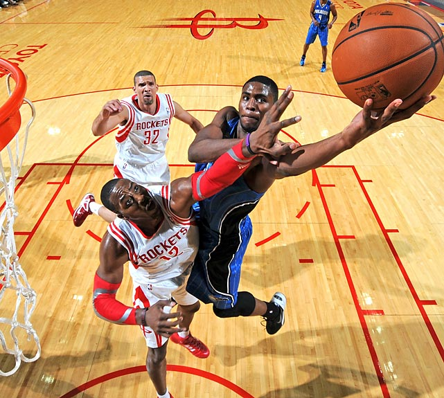 Orlando Magic forward Maurice Harkless elevates over Houston Rockets center Dwight Howard during a preseason game.