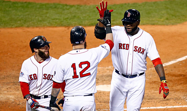 More than 14 million people watched the Red Sox, led by David Ortiz (right), roll to an 8-1 victory over the Cardinals.