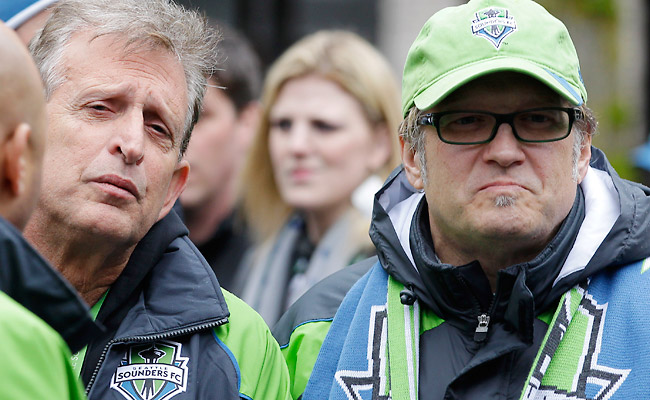 Seattle Sounders owners Joe Roth (left) and Drew Carey look on prior to a fan rally in 2011.