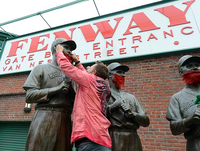 "The former member of Boston's 2004 World Series Championship team slyly defaced the ""Teammates"" statues before Game One of the World Series between the Red Sox and St. Louis Cardinals at Fenway Park."