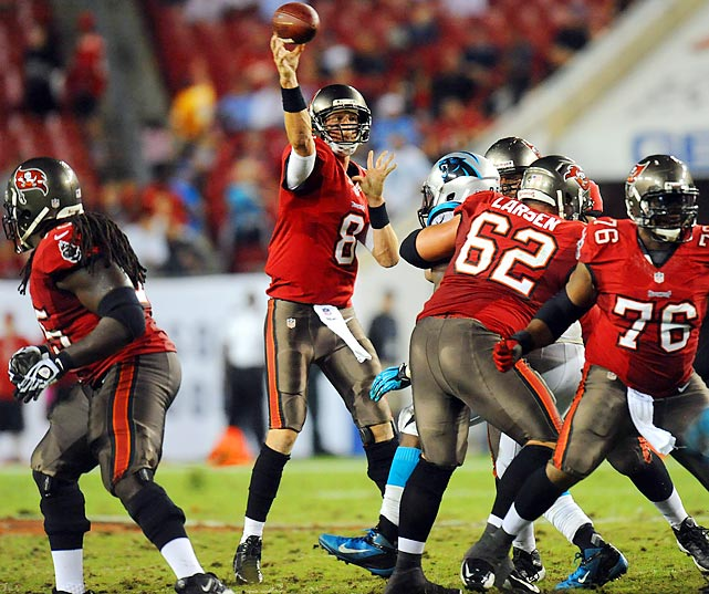 Tampa Bay quarterback Mike Glennon gets a throw off in the face of the Panthers' pass rush.