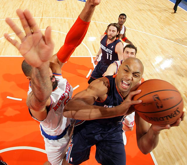 Knicks center Tyson Chandler maintains verticality against Gerald Henderson and the Bobcats.
