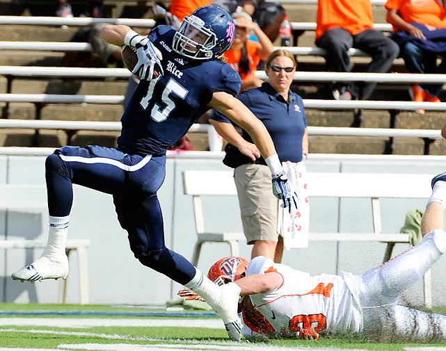 Rice wide receiver Jordan Taylor breaks a tackle by UTEP's Wesley Miller en route to a touchdown.