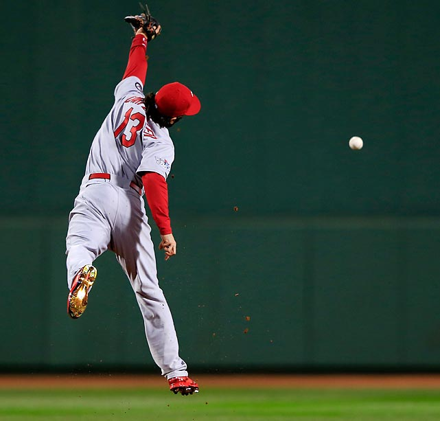 St. Louis second baseman Matt Carpenter tries to make a catch on a ball hit over his head in Game 1 of the World Series.