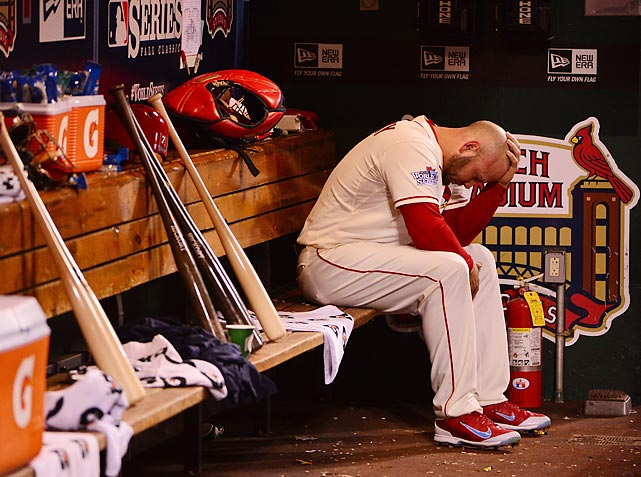 Cardinals outfielder Matt Holliday sits at the end of the bench during Game 3 of the World Series.