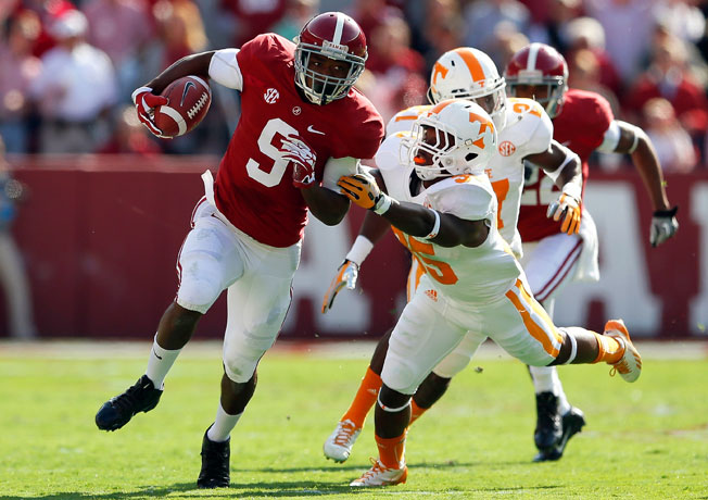 Wide receiver Amari Cooper (9) and Alabama routed Tennessee to improve to 8-0 on the 2013 season.