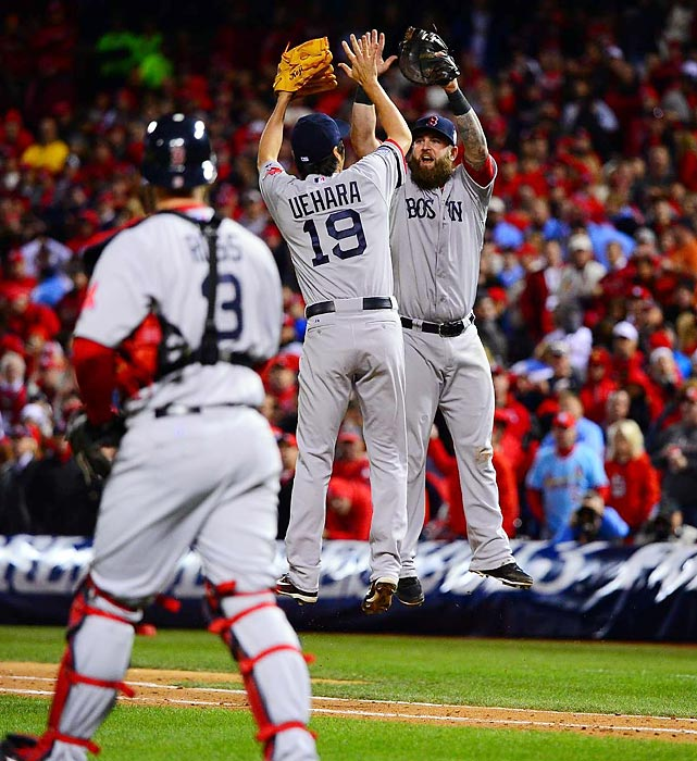 Red Sox closer Koji Uehara celebrates with first baseman Mike Napoli after Uehara picked off Cardinals pinch-runner Kolton Wong. It was the first World Series game to end on a pick off.