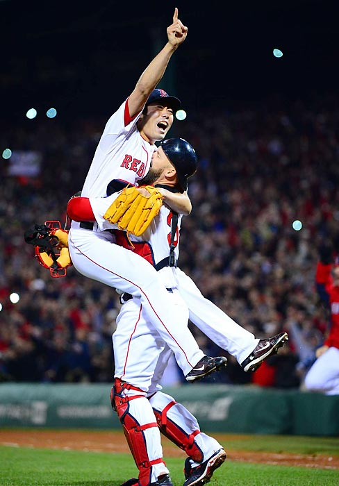 Koji Uehara celebrates with David Ross after Uehara struck out Matt Carpenter to end the series.