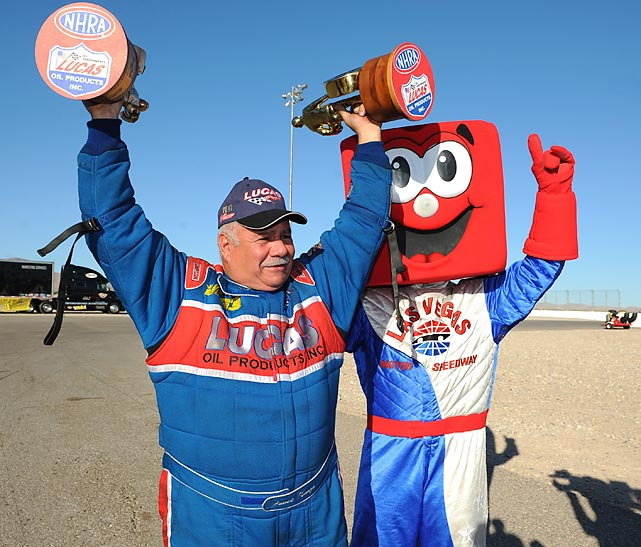 Frank Manzo cut loose with his buddy Pit Boss after winning the Top Alcohol Funny Car (it runs on a high-octane mix of gin, vermouth and triple sec) title at Las Vegas Speedway.