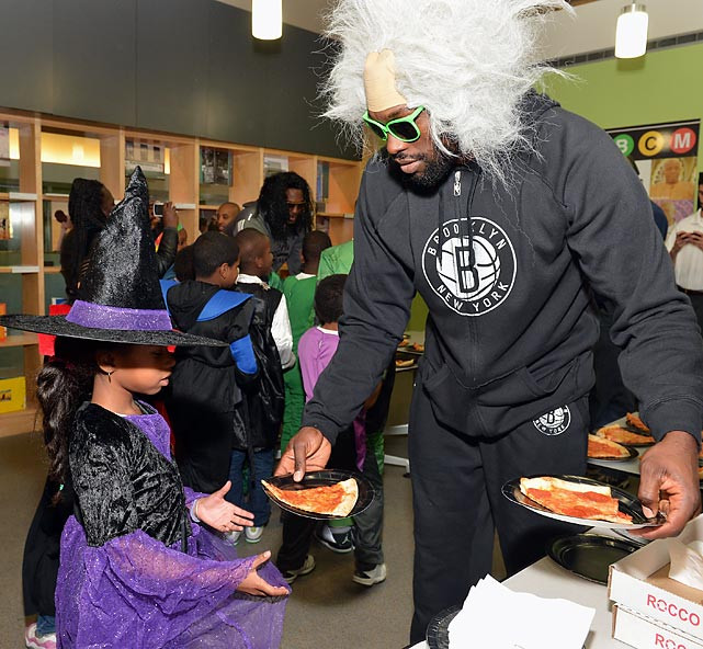 The Brooklyn Nets forward graciously hosted a Halloween Monster Mash for kids at The Brooklyn Children's Museum in New York City where actual children such as this one are on display.