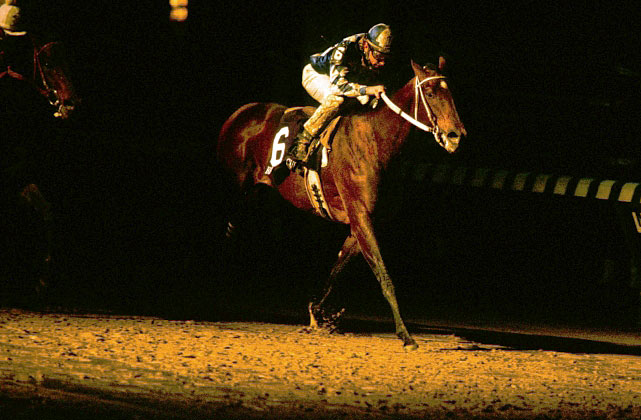 The 1987 Derby winner had narrowly lost the Classic the year before to '86 Derby winner Ferdinand at Hollywood Park. But Alysheba had followed up that defeat with victories in six of his eight starts in '88. At Churchill Downs on Nov. 5, rain had turned the track muddy, and darkness was about to fall when the gates opened for the Classic. Alysheba (6) got bumped at the start, but got up to stay near the lead before taking over in deep stretch and holding off Seeking the Gold. Alysheba finished his career that day as racing's all-time leading money winner, with $6,679,242.