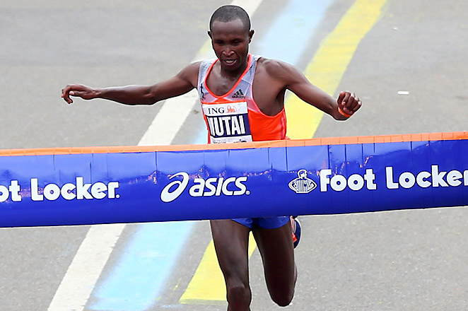 Kenya's Geoffrey Mutai crossed the finish line first in 2:08:24 to defend his 2011 title.