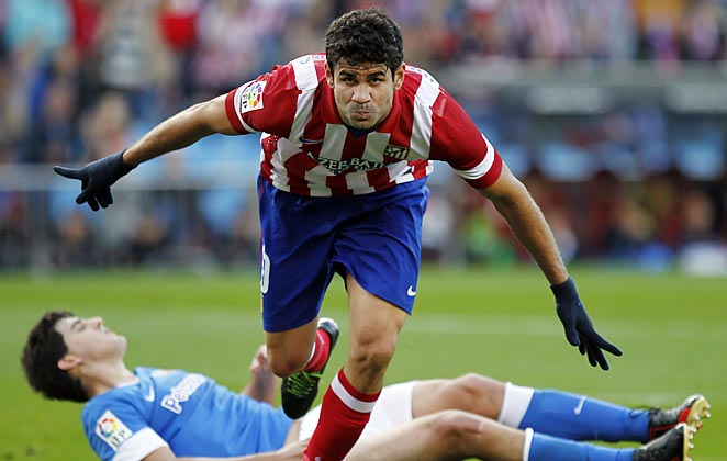 Diego Costa scored a goal as Atletico kept the pressure on La Liga leaders Barcelona.