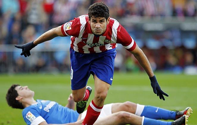 Diego Costa scored a goal as Atletico kept the pressure on La Liga leaders Barcelona.