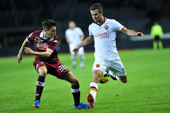Miralem Pjanic (right) and Roma had their 10-game winning streak come to an end with a draw against Torino Sunday.