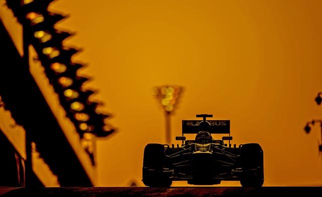 A driver cruises through the sunset in the Grand Prix of Abu Dhabi at the Yas Marina.