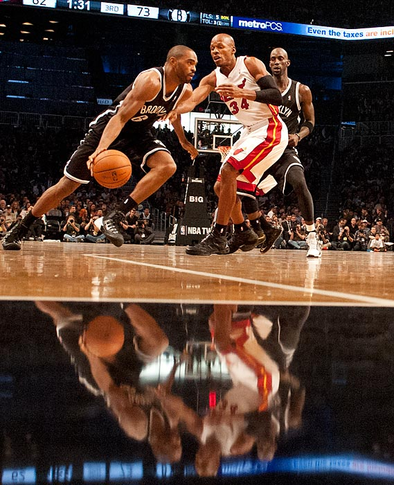 Nets forward Alan Anderson takes Heat guard Ray Allen off the dribble as the Barclays Center court reflects the action.