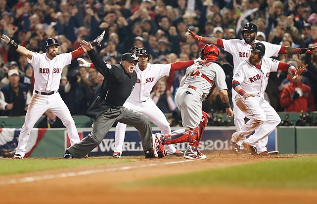 Home plate umpire Jim Joyce gets an assist from the Red Sox on his safe call on Jonny Gomes' scoring play in Game 6 of the World Series.