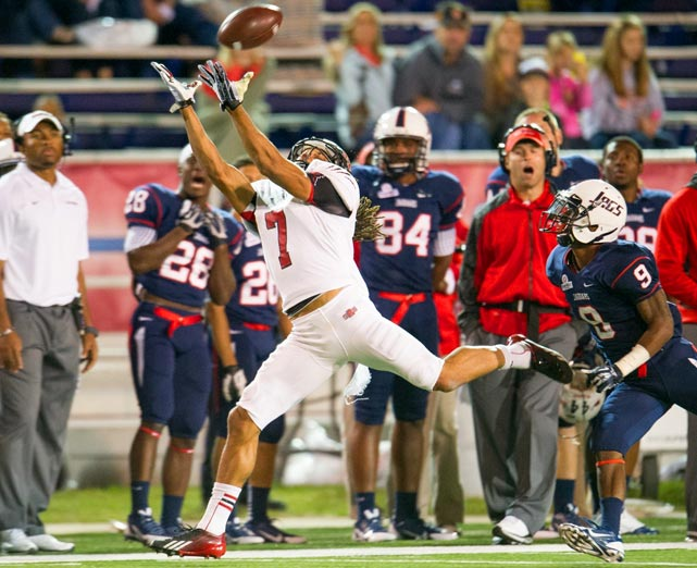 Arkansas State wide receiver Julian Jones hauls in a pass in front of South Alabama cornerback Tyrell Pearson. Arkansas State came back in the fourth quarter to win 17-16.