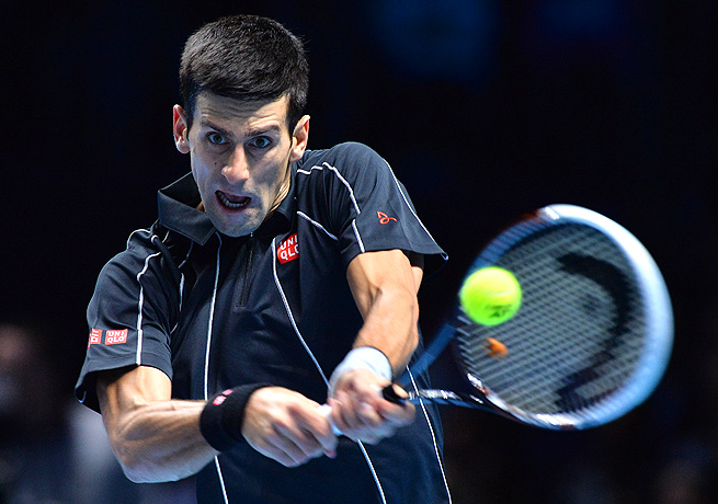 Novak Djokovic rolled past Roger Federer to extend his winning streak to 18 matches.