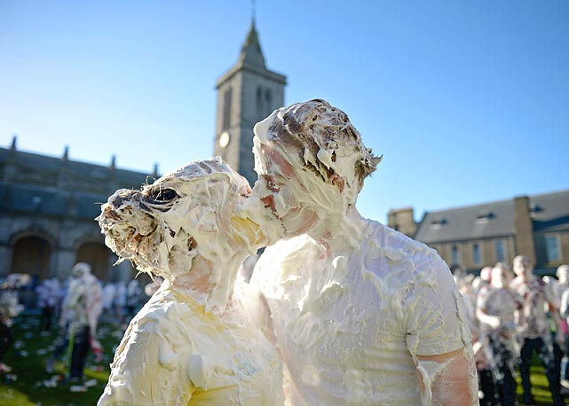 Concerned parents might like to know that students at St Andrew's University in Scotland indulge in a tradition of covering themselves with foam to honor the academic family. Raisin Weekend is held at the university's St Salvator's Quadrangle and a gift of raisins (now desert topping, shaving cream or insulating foam) is traditionally given by first year students to their elders as thanks for guidance and they receive a receipt in Latin, which no one can read. Sounds like a fair exchange.