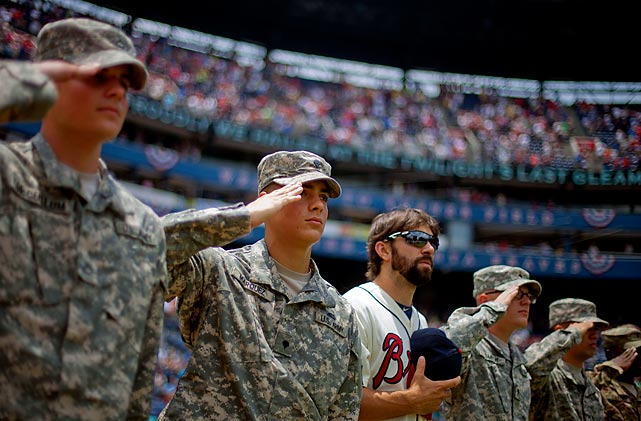 Members of the military join the Braves on the field for the national anthem before Atlanta's game against Diamondbacks in June.