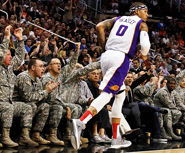 Members of the military cheer on Michael Beasley from courtside seats as part of the Suns' commemoration of Veterans Day in 2012.