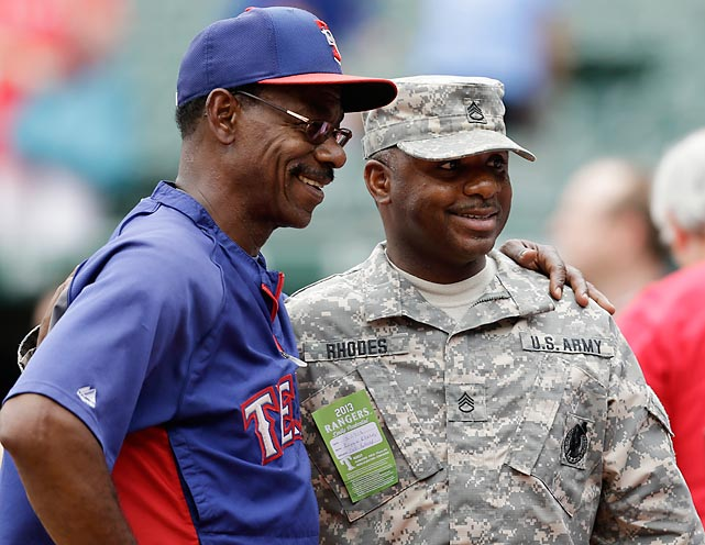 Texas Rangers manager Ron Washington poses with Army Staff Sgt. Reggie Rhodes before a Rangers game against the Diamondbacks in May.