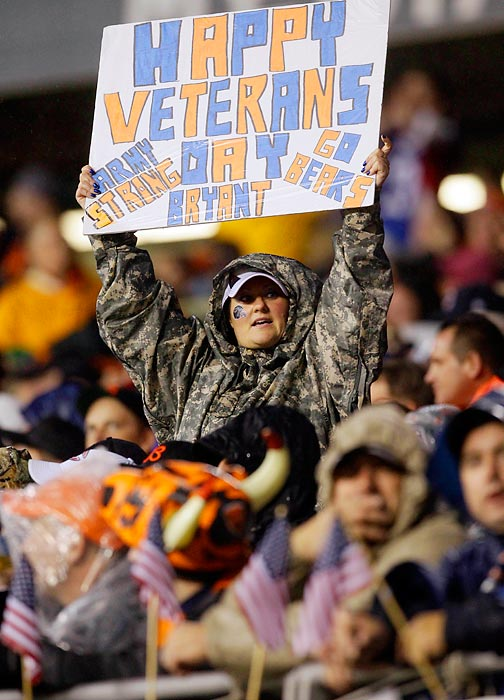 A Bear fan holds a sign honoring the military on Veterans Day at a Bears-Texans in 2012.