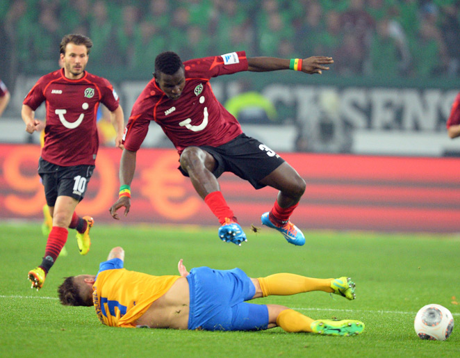 Hannover's leaping Mame Diouf and Eintracht Braunschweig's Ermin Bicakcic challenge for the ball in Friday's 0-0 Lower Saxony derby draw.
