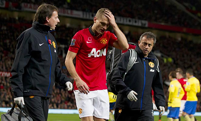 Nemanja Vidic left the game vs. Arsenal at halftime after suffering a head injury in a collision.