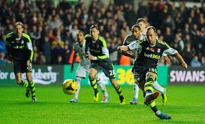 Charlie Adam converted a spot kick at the death to earn Stoke City a draw with Swansea.