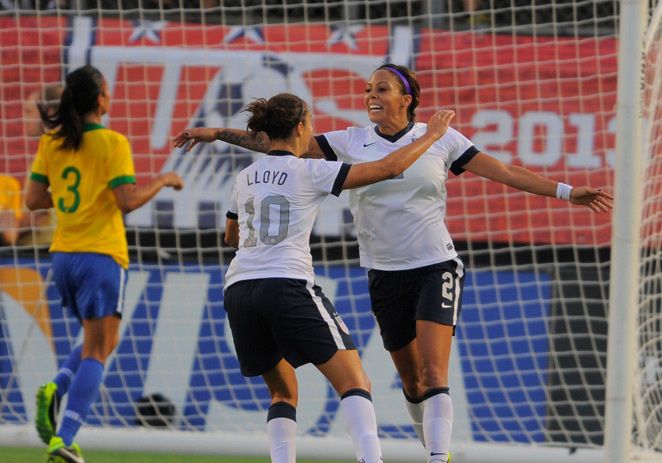 U.S. forward Sydney Leroux, right, celebrates with Carli Lloyd after a goal in the Americans' 4-1 victory over Brazil in Sunday's friendly in Orlando, Fla.