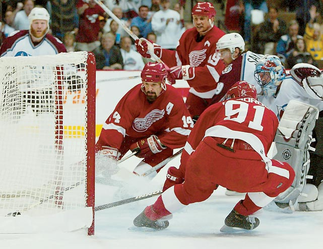 """Drafted by New Jersey second overall in 1987, Shanahan went to play for five teams (Devils, Blues, Whalers, Red Wings, Rangers) and become the only player in NHL history to score at least 600 goals and serve at least 2,000 penalty minutes. He epitomized the term """"power forward."""" He could beat you with his shoulder, his fists or his wrister. He had a hair-trigger temper that was a furious thing to behold, and it bought him the time and space he needed to become an elite sniper. Longevity rarely enters in the equation, but the fact that he was able to play the way he did for as long as he did is a marvel."""