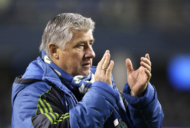 Seattle Sounders manager Sigi Schmid will return to the club in 2014 despite a disappointing playoff campaign that saw the club eliminated by rival Portland in the Western Conference semifinals.