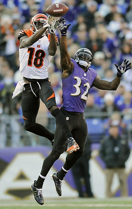 Bengals wide receiver A.J. Green pulls in a pass over Ravens safety James Ihedigbo. Green later caught a Hail Mary pass from quarterback Andy Dalton as time expired to send the game into overtime, but the Ravens held on to win 20-17.