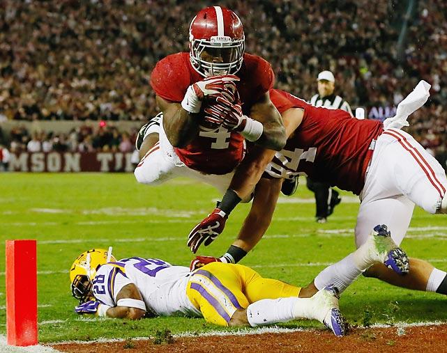 Alabama running back T.J. Yeldon scores a touchdown against LSU.