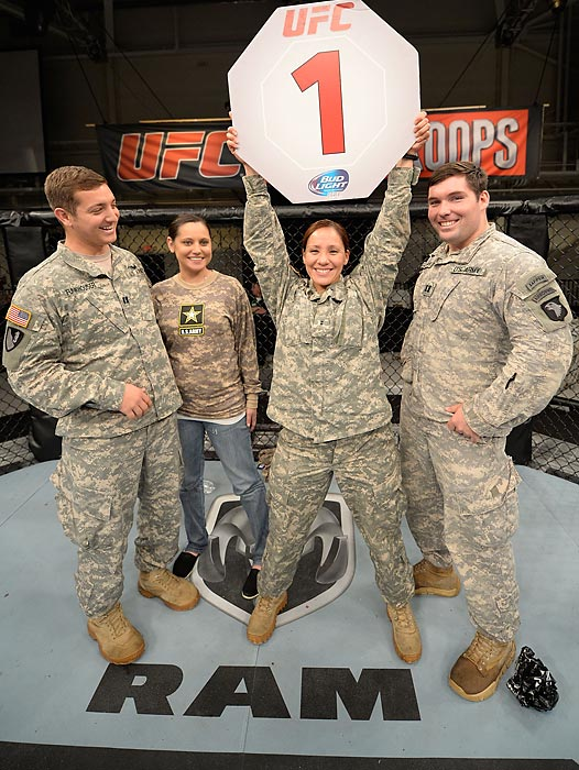 Members of the Army pose inside the Octagon after the UFC Fight for the Troops event in November in Fort Campbell, Ky.