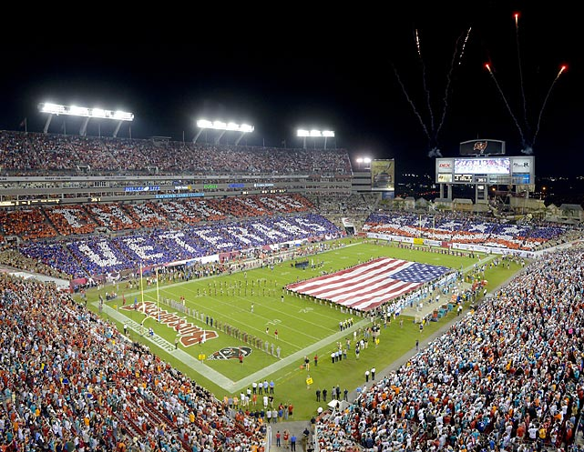 Fans at the Buccaneers game against the Dolphins on Veterans Day in 2013 participate in a 50,000-person card stunt to honor the military.