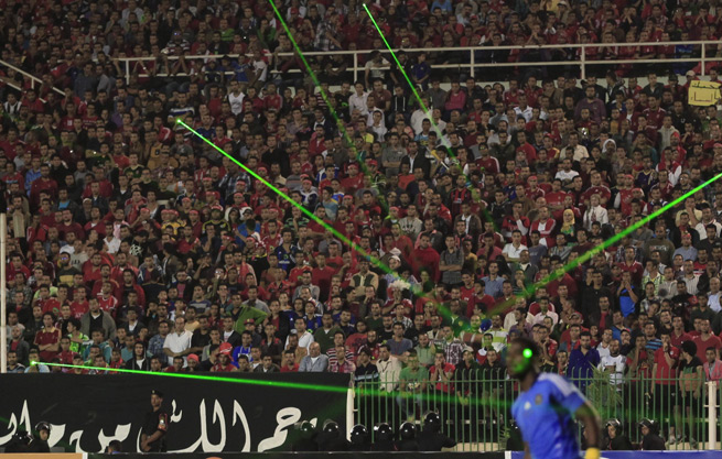 Al Ahly fans shine lasers on the face of Orlando Pirates goalkeeper Senzo Meyiwa during their African Champions League final in Cairo this past Sunday.