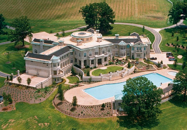 In January 2014, Rick Ross bought former heavyweight champion Evander Holyfield's mansion in Atlanta for $5.8 million. Holyfield had lost the home to foreclosure in 2012, after he owed the bank $14 million.  The 54,000 square-foot house has an astonishing 109 rooms, including 12 bedrooms and 21 bathrooms.  It has a dining room that sits 100 guests, an indoor and outdoor pool, a bowling alley and a home theatre as well.